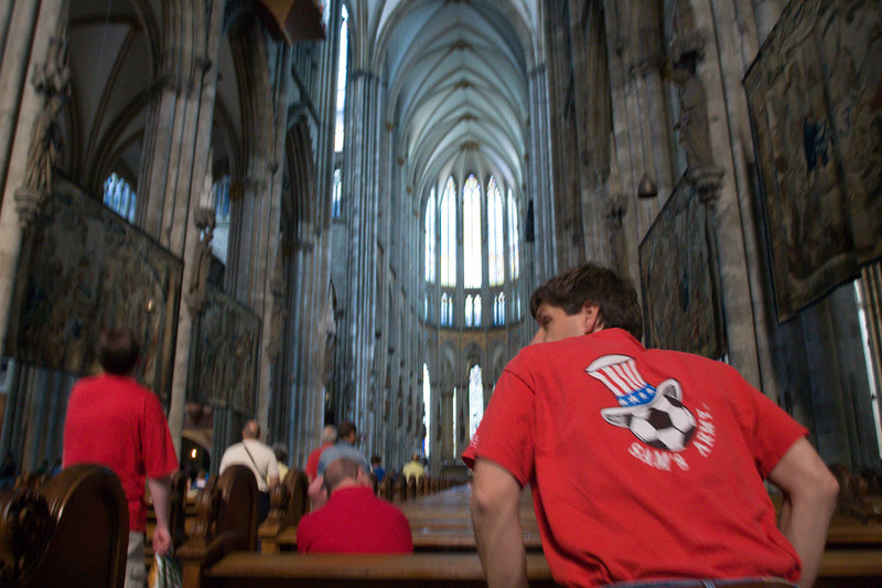 USA fan (Sam's Army) prays inside the Dom (Cathedral) in Köln.  His prayers would go unanswered.
