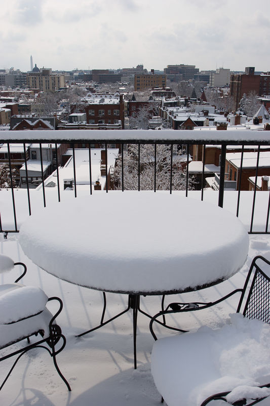 the roof deck of our apartment building, looking out towards downtown DC (with the Monument on the upper left)