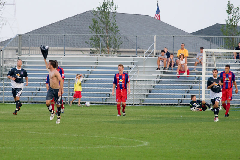 Palace USA's Rade Kokovic celebrates his scorcher of a goal by taking his shirt off.  His goal tied the game at 1-1.