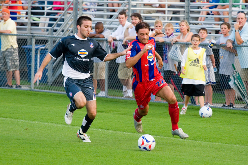 Marco Reich challenged by Rade Kokovic along the left wing.