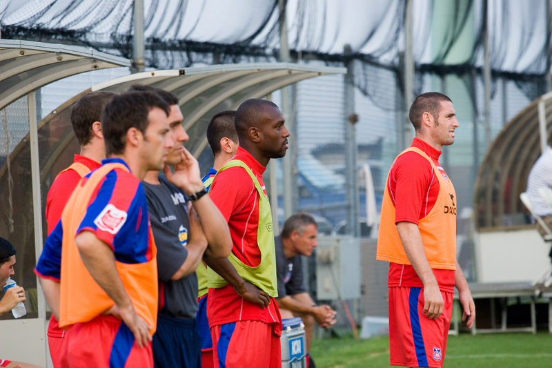 Dougie Freedman, Emmerson Boyce and Mark Kennedy watch as half time approaches.