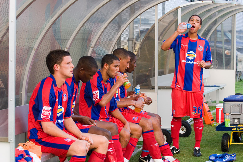 Mark Hudson, Leon Cort, Jobi McAnuff, Jay Bothroyd, Arron Fray and Lewwis Spence replenish their fluid levels at half time on a hot, muggy evening in Annapolis.