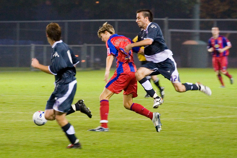 Rade Kokovic was booked for this over-enthusiastic challenge from behind on Charlie Sheringham.