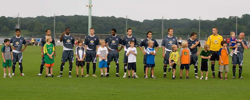 The Palace USA team, wearing the Palace away kit, lines up before the match.