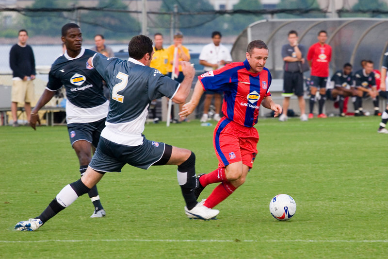 Michael Hughs cuts past Marcus Gross as he heads for the box.