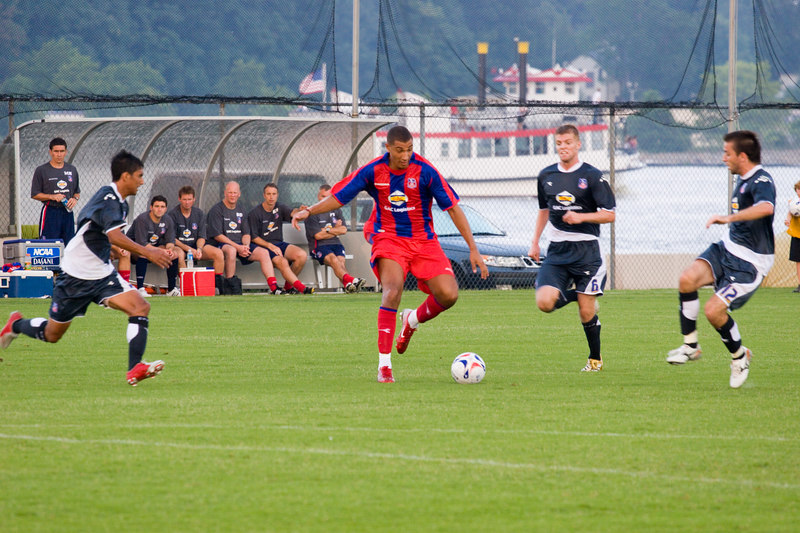 Trialist, Jay Bothroyd gets closed down by a determined Palace USA side.