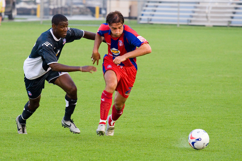 Marco Reich beats Maurice Edu to the ball on a damp field in Annapolis.