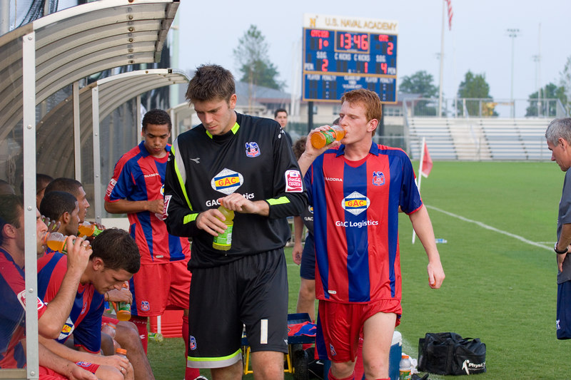 Scott Flinders and Ben Watson getting their refreshments at half time.