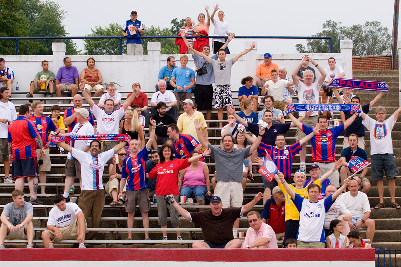 The travelling Palace supporters wave for the camera.