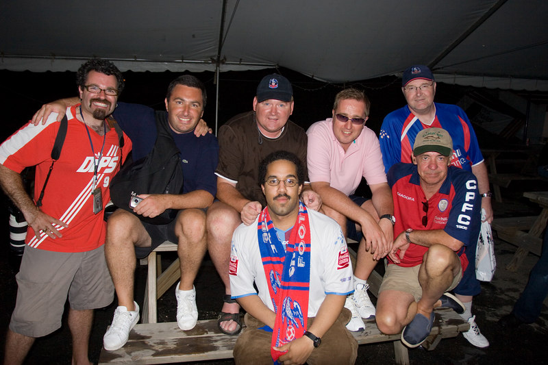 Michael, Paul, Chas and other unidentified Palace fans sheltering under the tent.