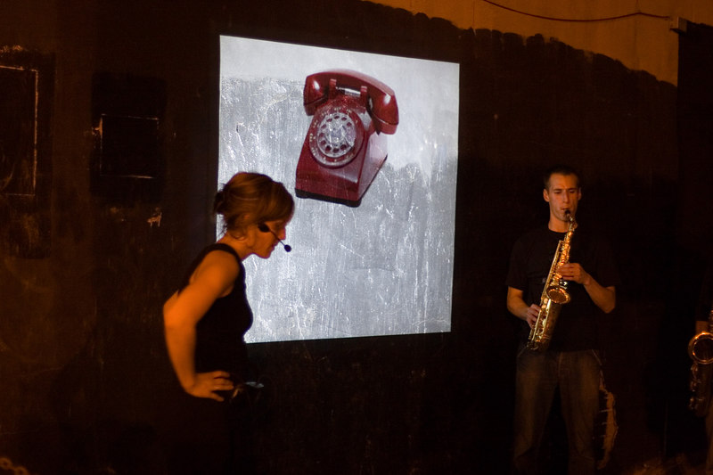 performance art, telephone image and saxophonists.