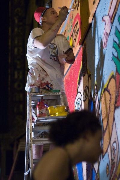 matt signs the mural.