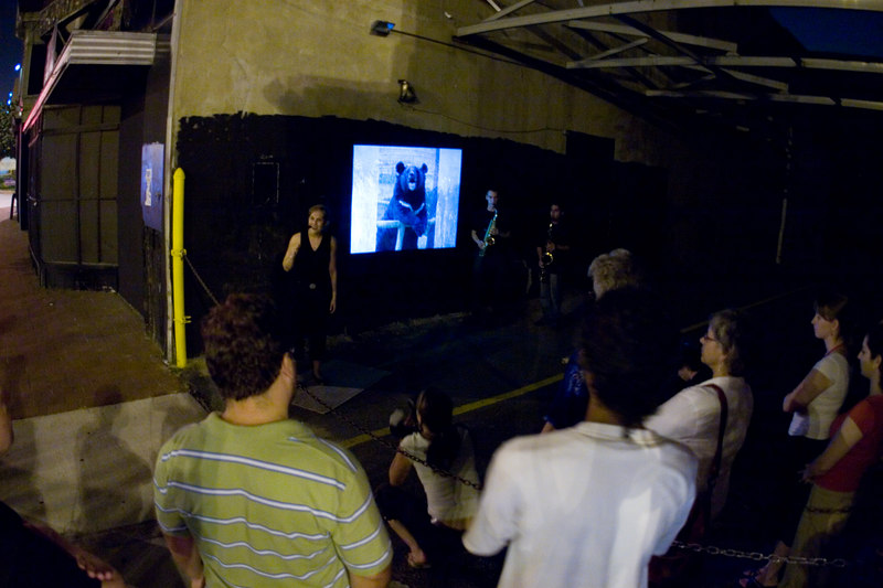performance art in the alley next to the Warehouse theatre, 7th and L sts nw (yes, that's an image of a bear projected on the alley wall).