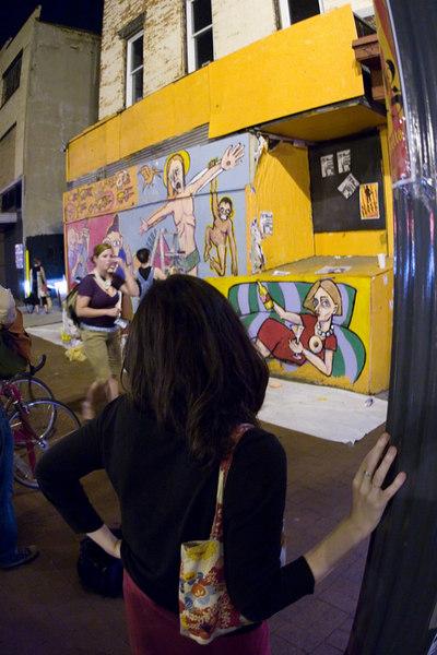 kim raue watches the mural unfold.