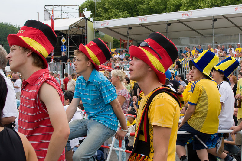Germany and Sweden fans in their big hats, watching the England v. Trinidad & Tobago match at the Fan Mile in Berlin.
