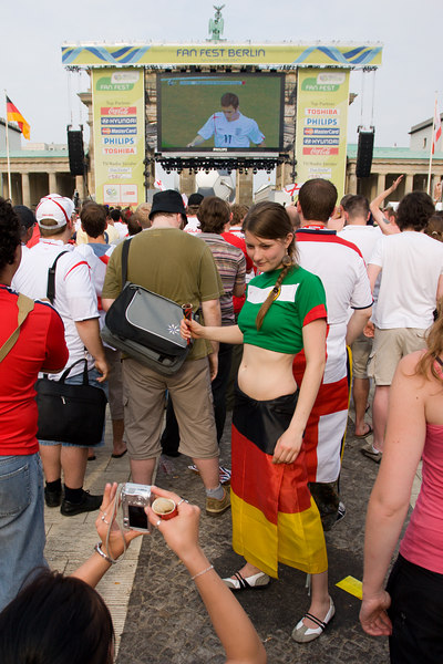 A Mexico fan has her picture taken with Joe Cole at the Fan Mile in Berlin while the England v. Trinidad and Tobago game is broadcast.
