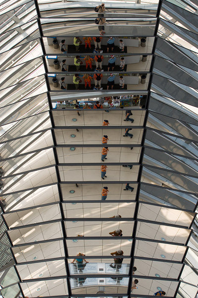 Alexi and i queued for an hour for the privilege of walking up the glass dome atop the Bundestag.  the mirrored central column made it seem like there were more people there than in reality.