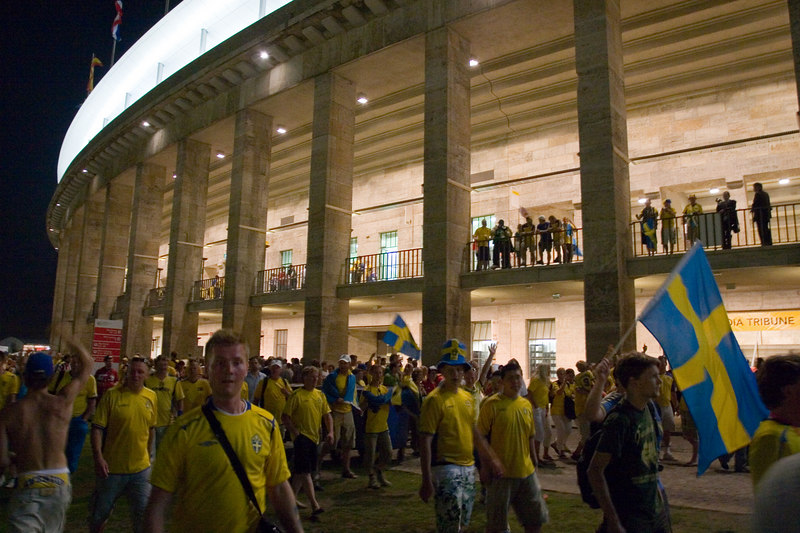 Swedish fans stream past the imposing columns of the Olympiastadion.