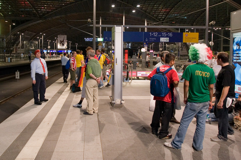 Midnight at the train station - Paraguay, Sweden, Czech and Mexico fans (and a DB employee with the spiffy red beret) represented on the platform at Berlin's Hauptbahnhof.