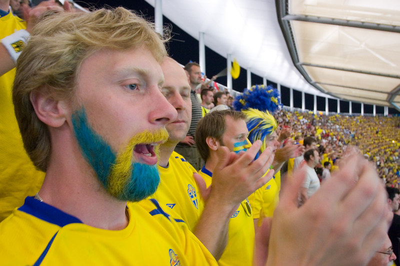 Happy Sweden fan with patriotic beard.