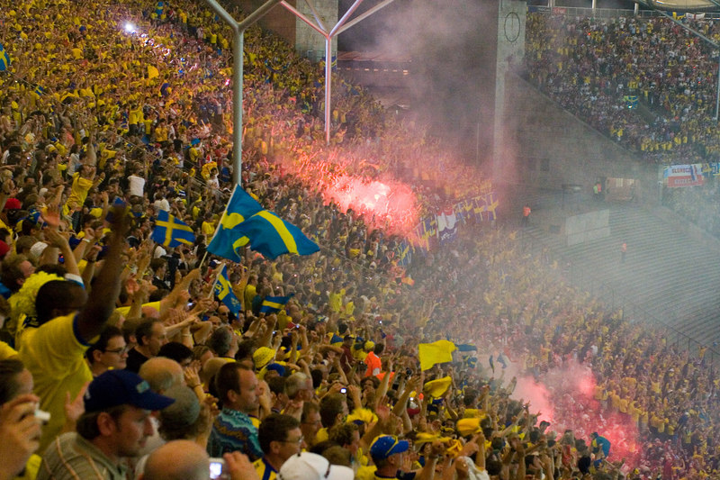 Flares go off in celebration of Sweden's last gasp goal.