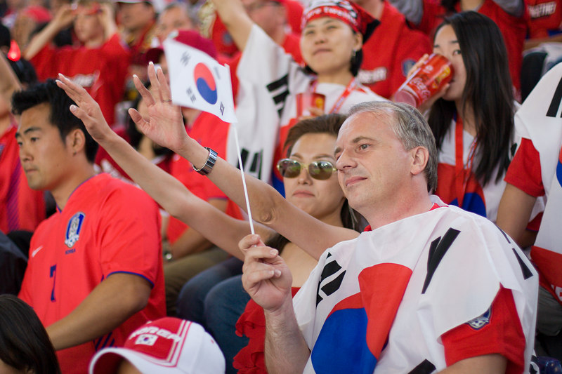 Trying to make the best of the situtaion, the South Korea fans cheer their team on in Hannover, despite being 1-0 down to Switzerland at half-time.