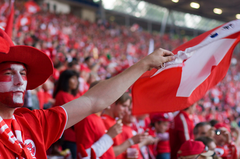 Switzerland fan at the game against South Korea at Hannover stadium .