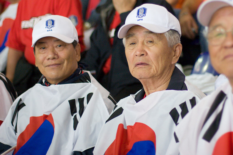South Korea fans try to keep their hopes up as their team goes down 2-0 to Switzerland in Hannover.