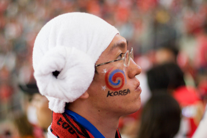 South Korean fan, with towel wrapped around his head, looking not so pleased at half-time in Hannover.