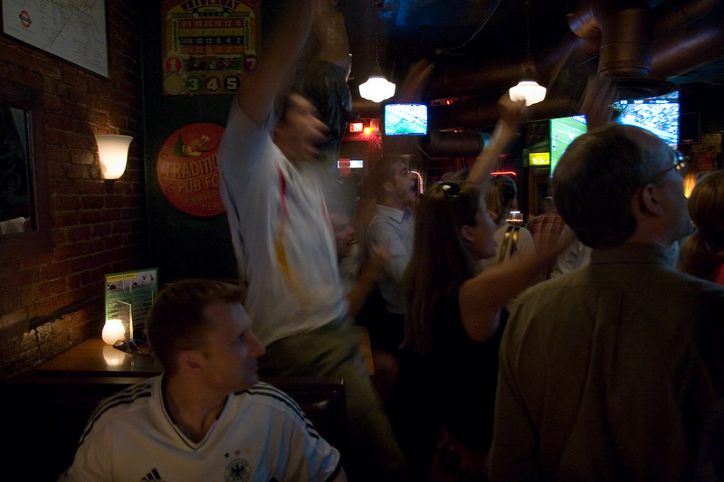 german fans celebrate the opening goal of World Cup 2006 at Lucky Bar in Washington DC