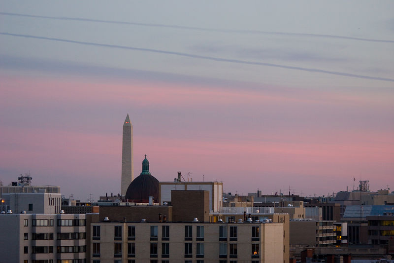DC skyline at dusk, with the Washington Monument and St Matthews Cathedral.