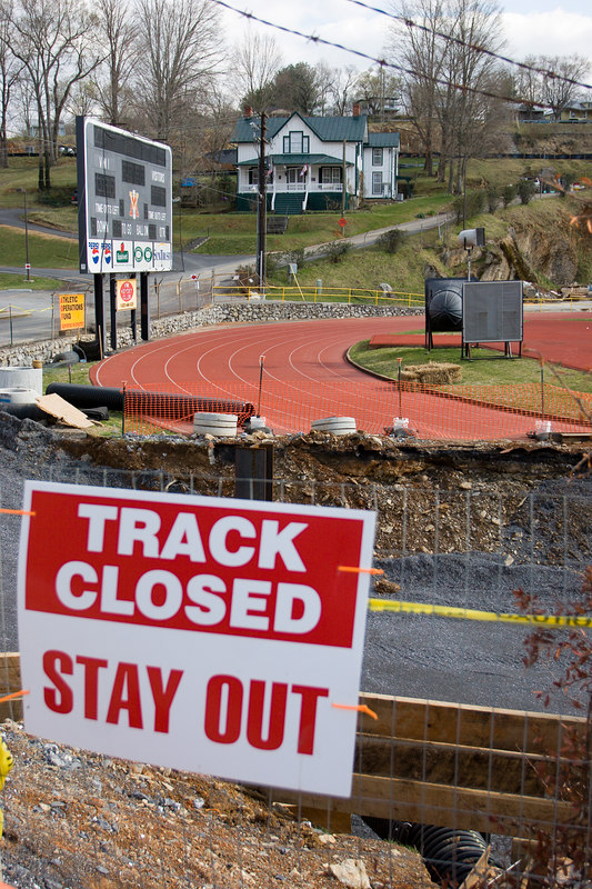 the big sign was most helpful in case you missed the fact that half the track had been replaced by a 40 foot wide, 10 foot deep trench -  the VMI (Virginia Military Institute) athletic field, Lexington VA.