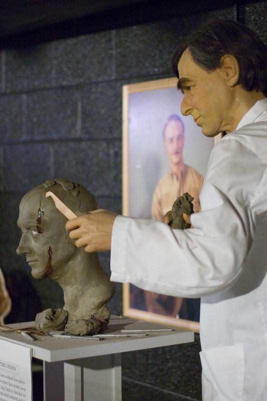 "This part of the factory tour exhibit showed a ""sculptor"" at work on a figure's head. The wax model in the lab coat demonstrating the technique was not identified as Democratic presidential candidate Michael Dukakis, but as you can see, it was his likeness they used. I guess he is no longer worthy of a place in the regular museum."