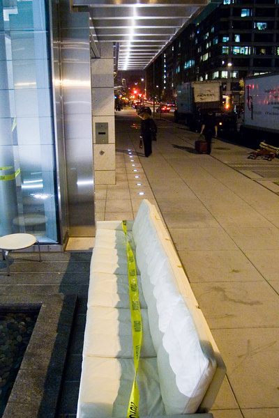 left work late tonight and came across this long white sofa on the sidewalk in front of 1819 H St NW.
