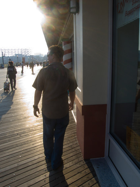 mike striding out on the boardwalk as a single man for the very last time...