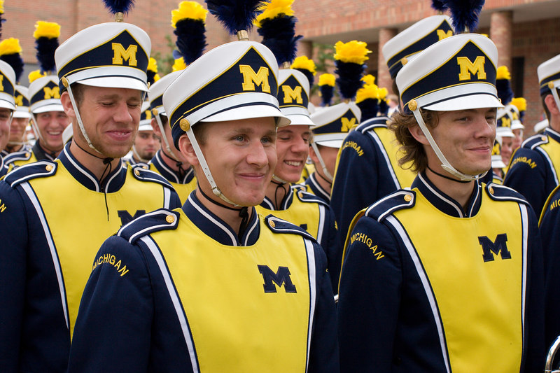 marching band trying to remain serious while friends taunt them