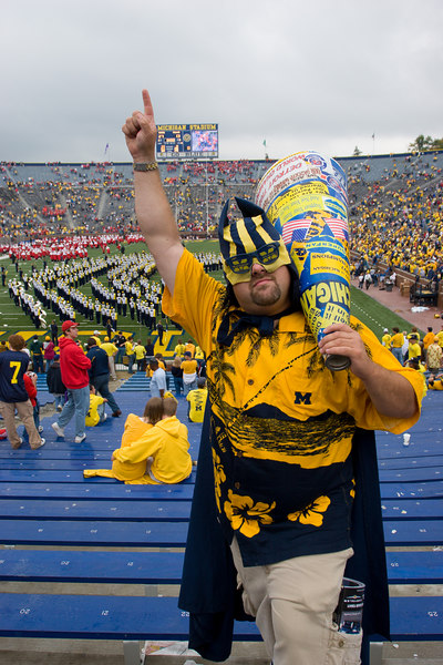 mega-fan with mega-phone after the game (a victory for michigan 27-13 over wisconsin)