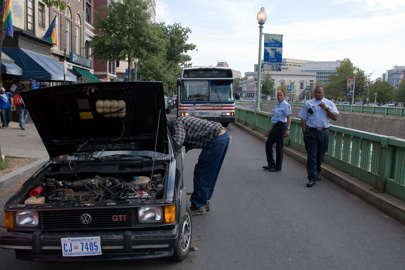 i'm not sure exactly why it was taking so long, but this car was perched precariously on a jack while the owner dealt with a flat front right tire - this blocked bus passage along it's normal route along Connecticut in the first block north of Dupont Circle.  obviously the car couldn't be moved, as, by the time i stumbled on the scene, four number 42 buses were backed up in a row.