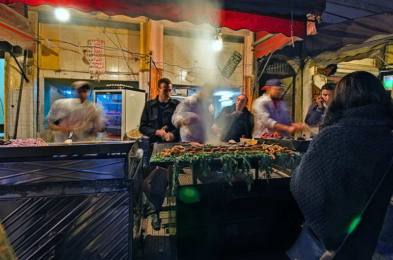 Organic fast food. Moroccans making fast food on the streets at night. Burgers with pita and meet, lamb brains or liver.