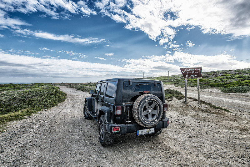 Yes! We did it! Vilnius to Cape l'Agulhas 23000 km; 40 days; 13 border crossings on West side of Africa. No, this was regular Jeep Wrangler Unlimited 2.8 CRD. No modifications was made for overlanding Africa except tires. Yes - we drove on rainy season.  No - there was no support team, no other overlanders driving in convoy, we did it alone. In fact - we did not meet ANY other overlanders from Mauritania to Namibia. Yes - there some dangerous places where You can get lost (forever), kidnapped, bite by snake or Tsetse Muse.