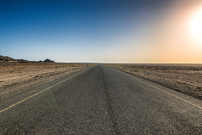 Heat. Open road. Masirah Island. 11 000 population, no one is around...