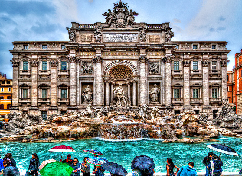 The Trevi Fountain. Rome<br /> Standing 26 metres (85.3 feet) high and 20 metres (65.6 feet) wide, It is the largest Baroque fountain in the city and the most beautiful in the World. A traditional legend holds that if visitors throw a coin into the fountain, they are ensured a return to Rome. Every day it spills 80.000 cubic meter of water (2,824,800 cubic feet).<br /> The Roman custom of building a handsome fountain at the endpoint of an aqueduct that brought water to Rome was revived in the 15th century, with the Renaissance.