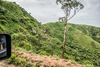 Jeep. 4WD. Low gear. Narrow road between Nigeria and Cameroon. Making pictures and trying survive mud...
