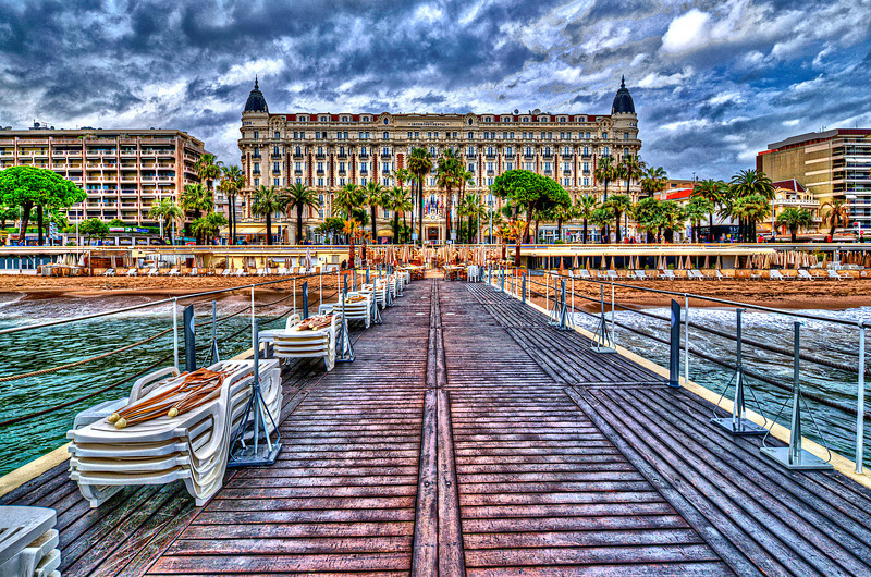 "The InterContinental Carlton Cannes is a 343-room luxury hotel built in 1911, located at 58 La Croisette in Cannes on the French Riviera and listed by the Government of France as a National Historic Building. During the Cannes Film Festival it is the most prestigious place to stay and the undisputed headquarters of motion picture industry deal-making. Part of the InterContinental chain, the Carlton is famous for hosting movie stars from around the world during the annual Film Festival. The hotel was also featured in Elton John's well-known 1983 music video for the single, ""I'm Still Standing""."
