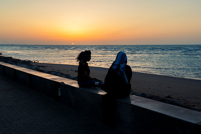 2 girls enjoin coffee during sun set in Muscat