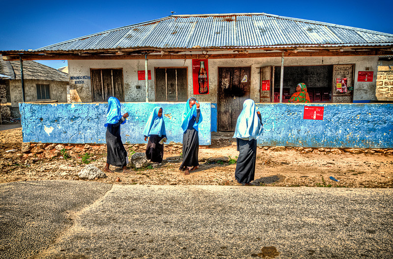 Girls school. Zanzibar.<br /> Girls immediately turn back on camera, or covering they face on photographer sight.