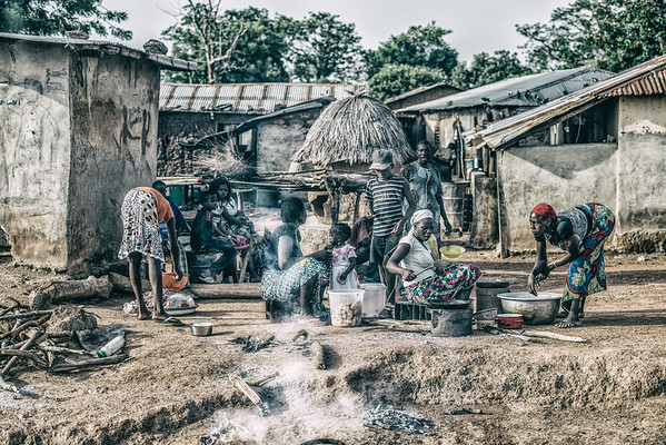 Ordinary day in Benin. Village community preparing food... and street art...