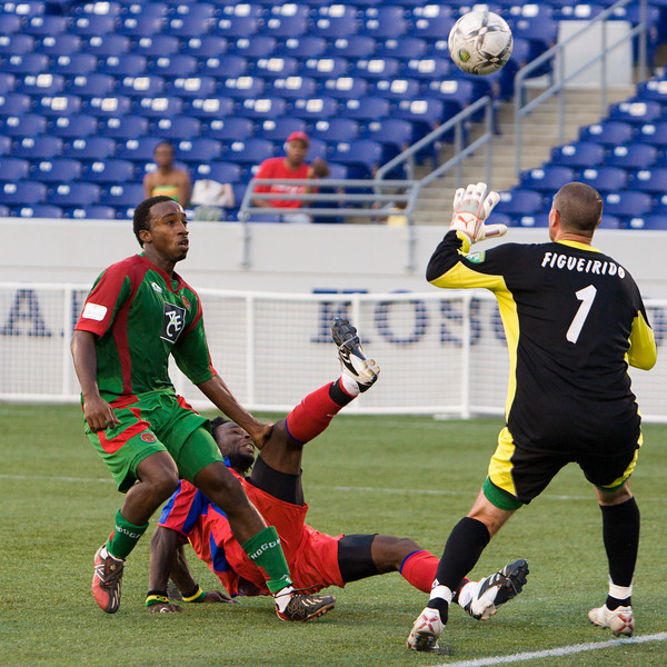 Gary Brooks' deft lob beats Bermuda's goalie to make it 3-0 Palace