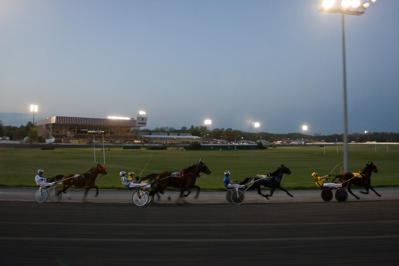 A race in progress, viewed from the starter's car, which continues to track the horses and riders for judging purposes