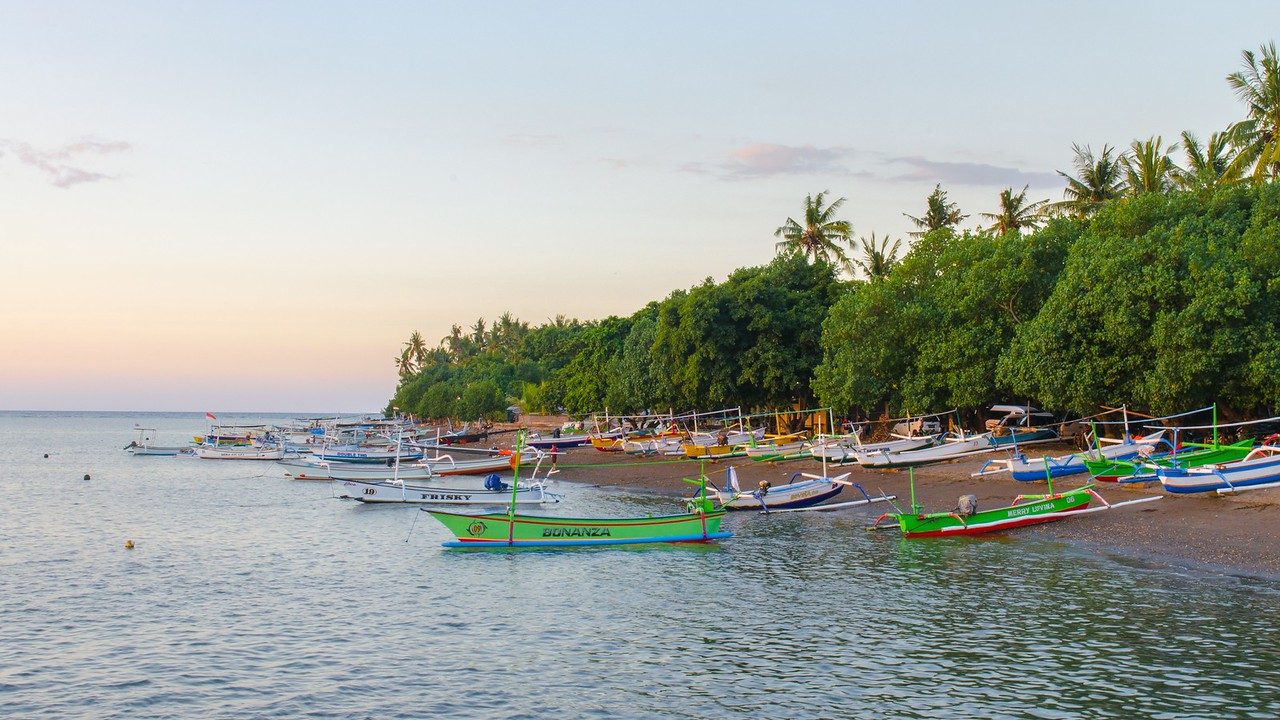 Balinese boats on the shore of Kalibukbuk Lovina